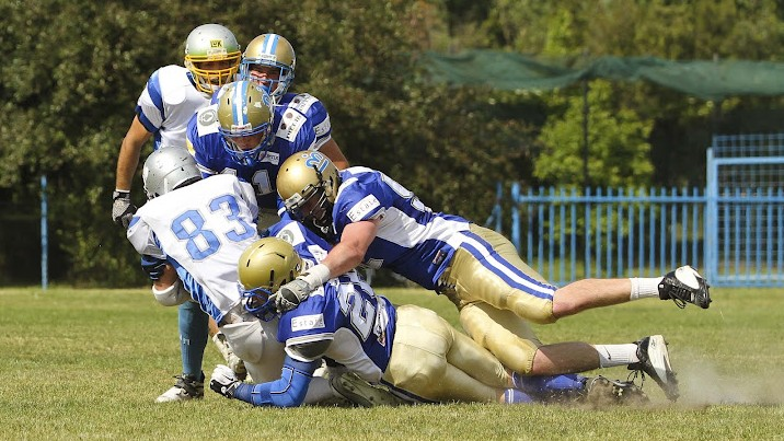 Monarchs' defenders swarm the receiver in Saturday's game