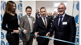 British Ambassador to Slovakia, His Excellency Mr Andrew Garth (centre) joins Helios Managing Director Nick McFarlane (right) and Slovakia Manager Juraj Jirků for the ribbon-cutting ceremony to celebrate the opening of the new Helios office in Žilina Slovakia.